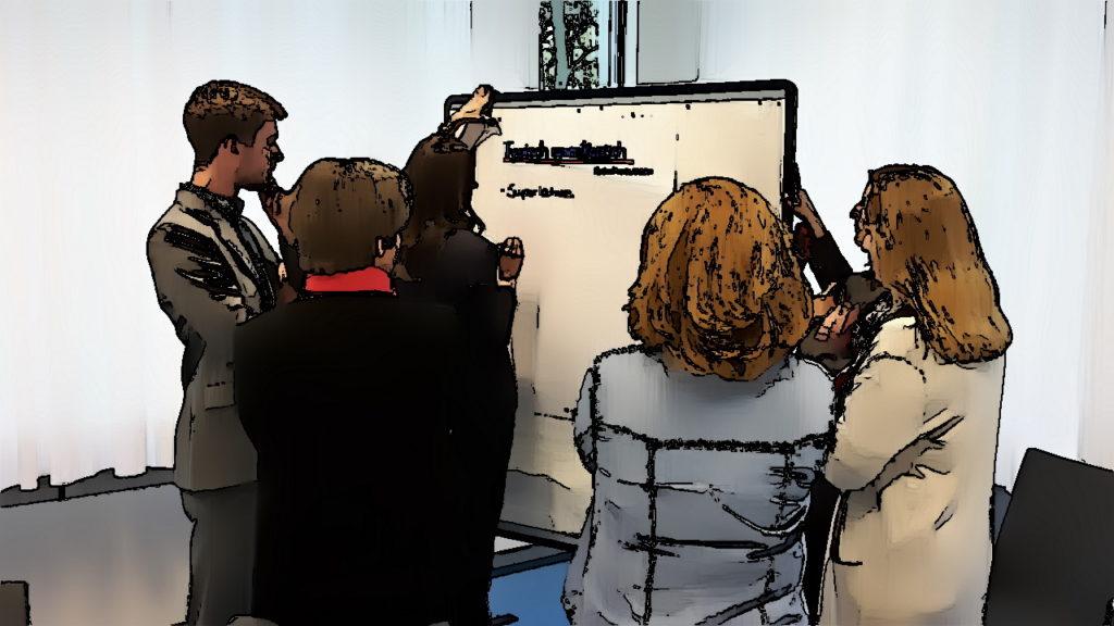 Seminargruppe bei Gruppenarbeit - gute Gründe für Präsenzschulungen
